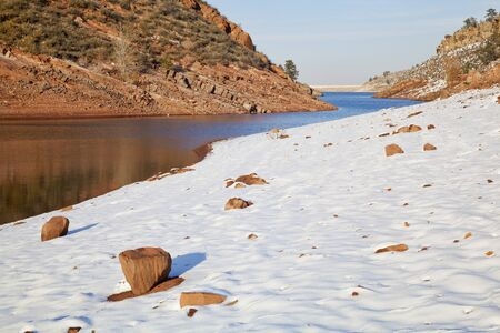 horsetooth reservoir: Horsetooth Reservoir near Fort Collins, Colorado in  winter scenery with a dam in distant view Stock Photo