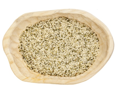 shelled hemp seeds on a rustic wooden tray isolated on white - top view Stock Photo - 11577593