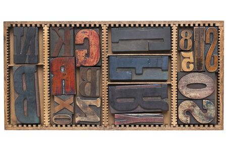 letters and numbers - a variety of vintage letterpress printing blocks  in a small wooden typesetter box with dividers, isolated on white Stock Photo - 11577602