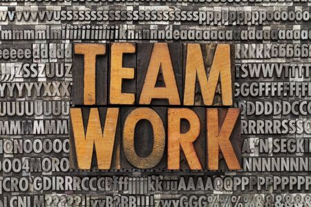 teamwork - text in vintage wood letterpress printing blocks against grunge metal typeset Stock Photo - 11577611