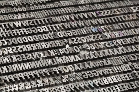 typesetting: letters, numbers and punctuation symbols in old grunge metal movable typeset