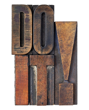 do it exclamation - motivation concept - isolated text in vintage wood letterpress printing blocks stained by color inks Stock Photo - 11788221