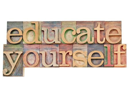 self development: educate yourself - personal development concept - isolated text in vintage wood letterpress printing blocks stained by color inks Stock Photo