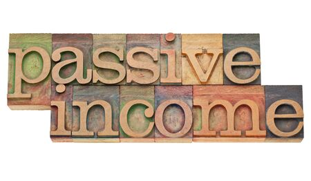 passive income: passive income - financial concept - isolated text in vintage wood letterpress printing blocks