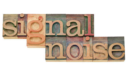 signal and noise - information concept - isolated text in vintage wood letterpress printing blocks Stock Photo - 11788226