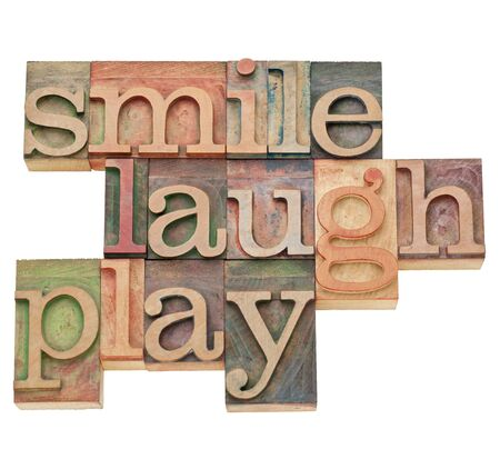 smile, laugh, play  - isolated word abstract in vintage wood letterpress printing blocks Stock Photo - 11788228