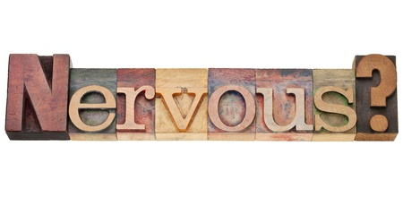 nervous question - isolated text in vintage wood letterpress printing blocks stained by color inks Stock Photo - 11788236