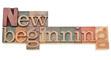 新たな始まり - ビンテージ木製活版印刷ブロック染色カラー インクの分離のテキスト