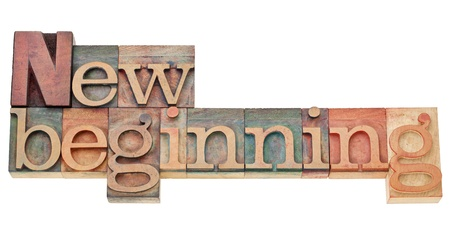 new beginning - isolated text in vintage wood letterpress printing blocks stained by color inks Imagens