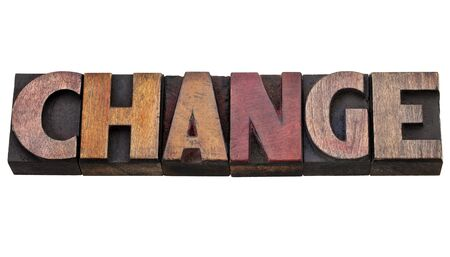 change - isolated word in vintage wood letterpress type, stained by color inks Stock Photo - 11788261