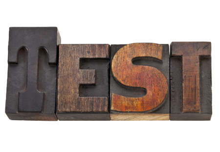 test - isolated word in vintage wood letterpress type, stained by color inks Stock Photo - 11788262