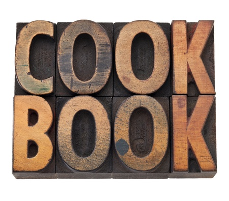 cookbook - isolated word in vintage grunge wood letterpress type, stained by color inks Stockfoto