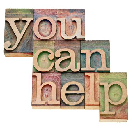 you can help - isolated text in vintage wood letterpress type, stained by color inks Stock Photo - 11788267