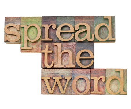 spread the word: spread the word  - isolated text in vintage wood letterpress type, stained by color inks