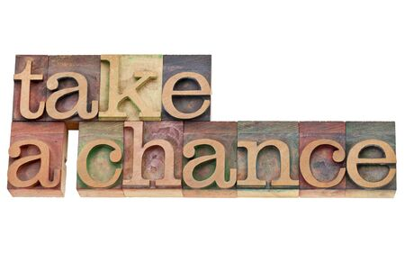 take a chance encouragement  - isolated text in vintage wood letterpress type, stained by color inks Stock Photo - 11788270