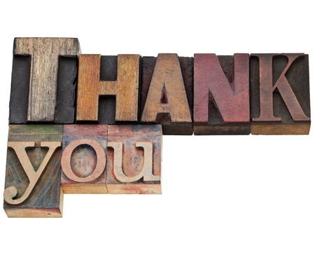 thank you - isolated text in vintage wood letterpress printing blocks stained by color inks photo