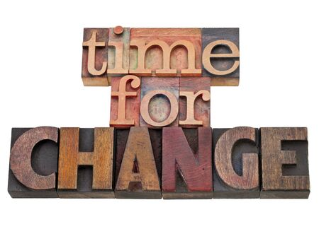 time for change - isolated text in vintage wood letterpress type, stained by color inks Stock Photo - 11788276