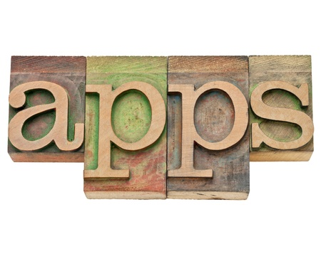 apps - application software for mobile devices   - isolated text in vintage wood letterpress type, stained by color inks Stock Photo - 11788244