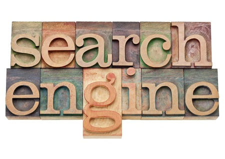 search engine - internet concept - isolated text in vintage wood letterpress printing blocks, stained by color inks photo