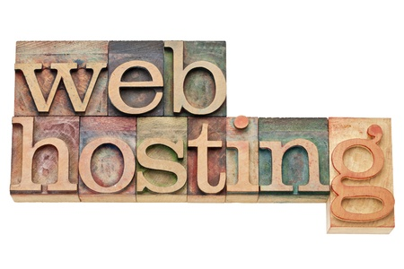 hosting: web hosting - internet concept - isolated text in vintage wood letterpress printing blocks, stained by color inks Stock Photo