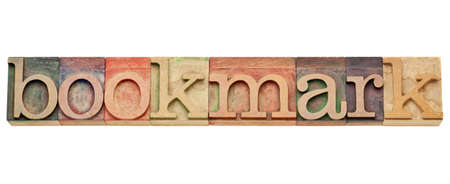 bookmark - internet concept -  isolated text in vintage wood letterpress type, stained by color inks Stock Photo - 11788254