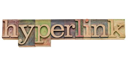 hyperlink: hyperlink - internet concept -  isolated text in vintage wood letterpress type, stained by color inks