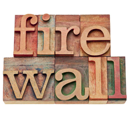 firewall - computer and internet security concept - isolated text in vintage wood letterpress printing blocks, stained by color inks Stock Photo - 11881305