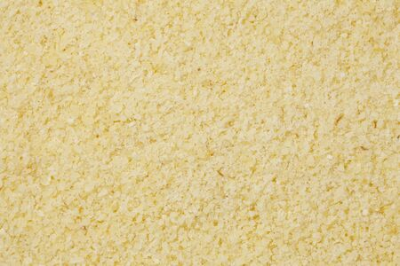 background of yellow semolina wheat flour at life-size magnification
