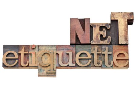 newsgroup: net etiquette - internet community concept   - isolated text in vintage wood letterpress type, stained by color inks
