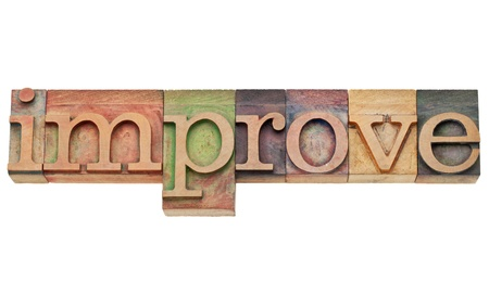 improve - motivation concept - isolated text in vintage wood letterpress printing blocks, stained by color inks Stock Photo - 11961335