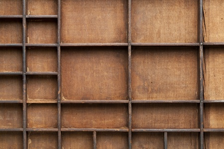 a detail of vintage grunge wood typesetter drawer with dividers Stock Photo - 11961338