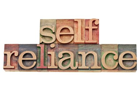reliance: selfreliance  -  isolatedword  in vintage wood letterpress type, stained by color inks Stock Photo