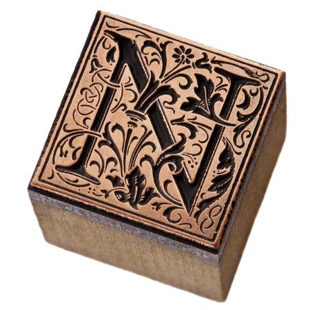 letterpress letters: ornamental initial letter N - copper and wood vintage letterpress printing block