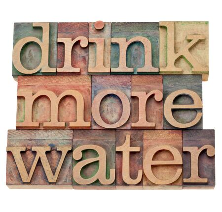 letterpress blocks: drink more water - hydration concept - isolated text in vintage wood letterpress printing blocks Stock Photo