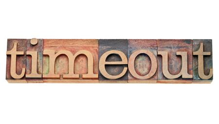 timeout word - isolated text in vintage wood letterpress printing blocks Stock Photo - 12029826