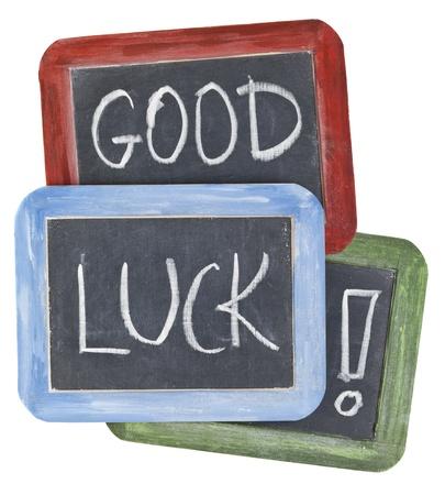 buena suerte: deseos de buena suerte - escritura de tiza blanca sobre pizarra pizarras peque�as con marcos de madera de colores Foto de archivo