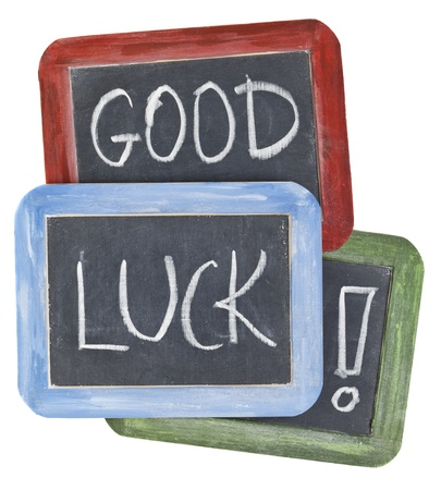good luck wishes - white chalk handwriting on small slate blackboards with colorful wood frames