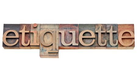 etiquette: etiquette - courtesy or protocol concept  - isolated text in vintage wood letterpress type, stained by color inks Stock Photo