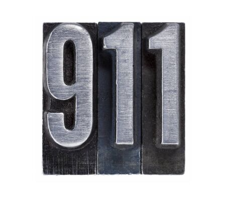 emergency phone number 911 or terrorist attack date - isolated text in vintage grunge metal letterpress type photo