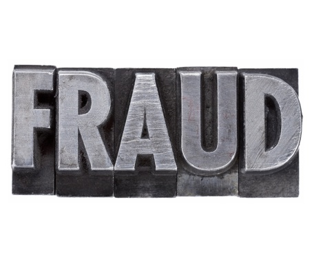 fraud - isolated word in vintage grunge metal letterpress type Stock Photo - 12114954