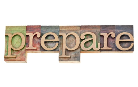 prepare - isolated word in vintage wood letterpress printing blocks stained by colorful inks