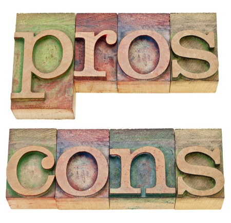 aspects: pros and cons - positive and negative aspects - a collage of two isolated words in vintage wood letterpress printing blocks