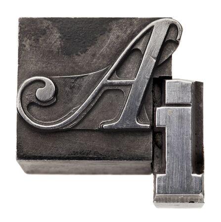 printing block: AI - artificial intelligence acronym - isolated vintage metal printing blocks