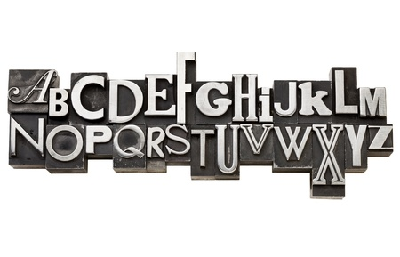 English alphabet in vintage metal type in two rows, a variety of fonts, isolated on white Banque d'images