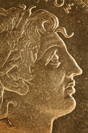 greek coins: Alexander the Great profile portrait, Greek king of Macedon  - magnified detail from old scratched coin