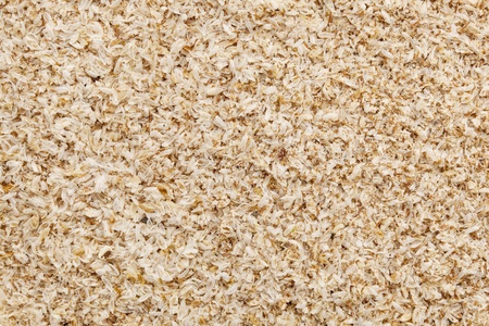 prebiotic: psyllium seed husks - dietary supplement, source of soluble fiber, macro texture background