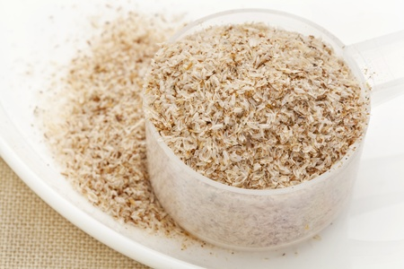 dietary fiber: measuring plastic scoop of psyllium seed husks - dietary supplement, source of soluble fiber