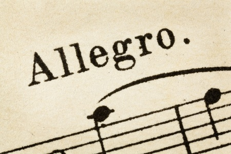 allegro: allegro -  fast, quickly and bright music tempo - macro detail from vintage sheet music Stock Photo