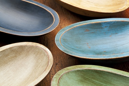 abstract composition  of five rustic painted dough bowls against grunge wood surface Stock Photo - 12358991
