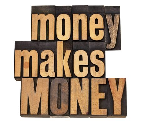 money makes MONEY - financial concept - isolated text in vintage wood letterpress type Stock Photo - 12358989